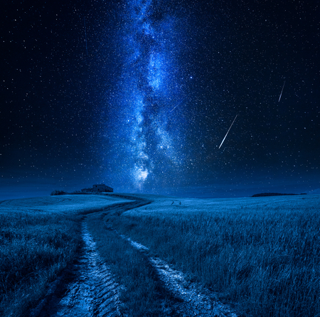Milky way and falling stars over country road, Tuscany