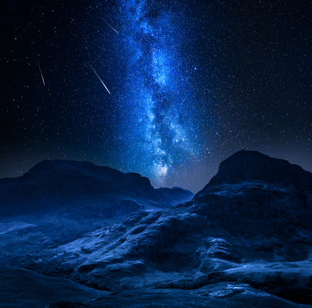 Milky way and falling stars in highland in Glencoe, Scotland Banco de Imagens