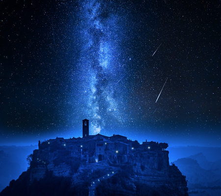 Milky way and falling stars over town of Bagnoregio, Italy
