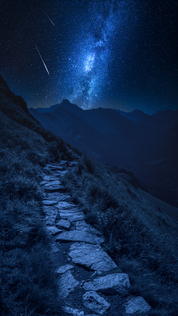 Mountains trail in Tatras at night with falling stars, Poland Stock Photo