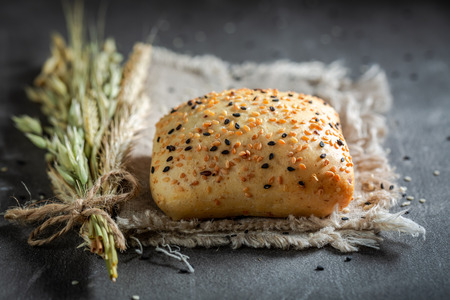 Homemade buns with wheat, ears and sesame seeds Stock Photo