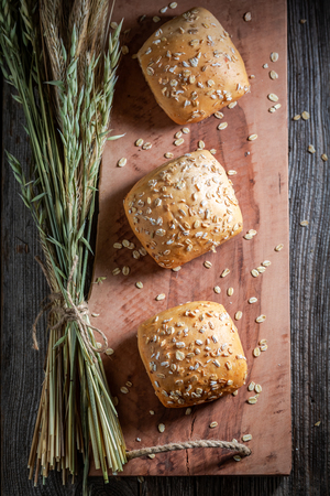 Top view of fresh buns made of oat flakes