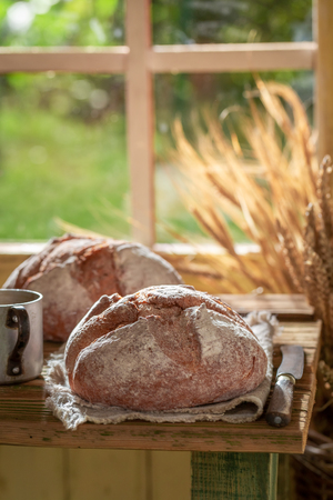 Healthy loaf of bread in rustic kitchen with coffee Stock Photo