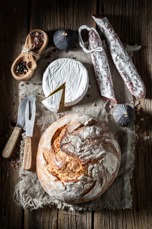 Homemade load of bread with sausage, camembert cheese and fig