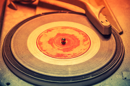 Vintage gramophone and old vinyls with scratched