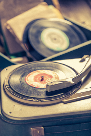 Old record player and old vinyls with scratched Reklamní fotografie