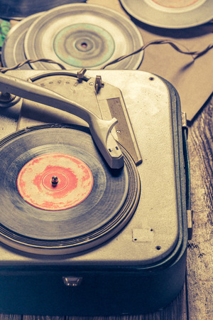 Classic gramophone and old vinyls with scratched Reklamní fotografie