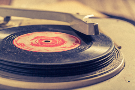 Vintage record player and few vinyl records