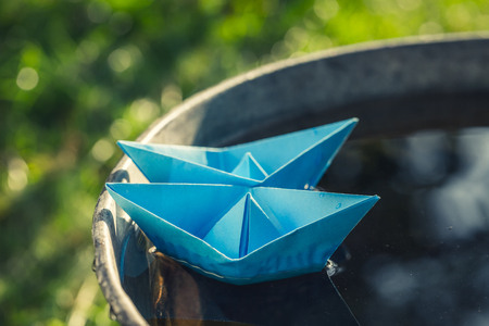 Handmade paper boats as toned and filtered photo