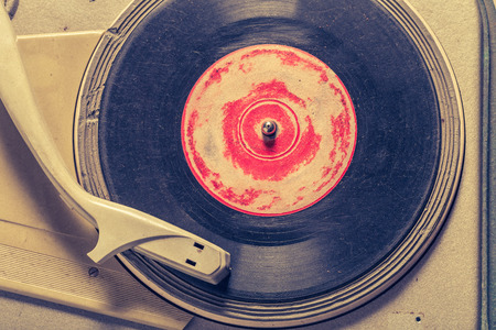 Retro gramophone and old vinyls with scratched Reklamní fotografie