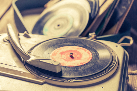 Closeup of old gramophone with a stack of vinyl records