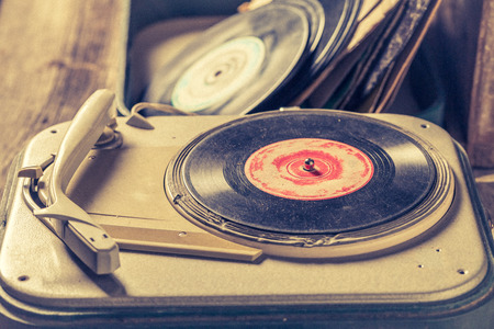 Retro record player and few vinyl records