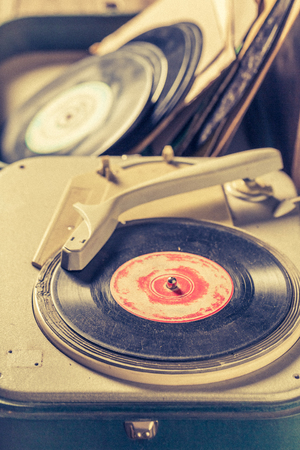 Vintage record player and old vinyls with scratched Reklamní fotografie
