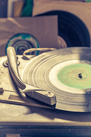 Classic record player and few vinyl records