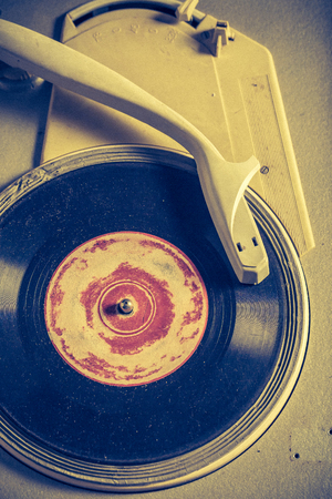 Antique gramophone and old vinyls with scratched