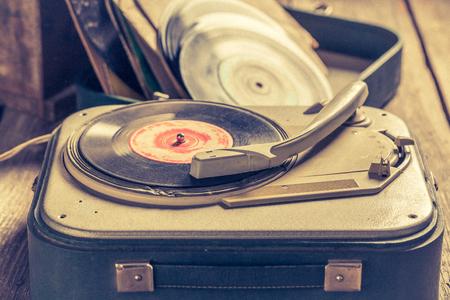 Old record player and few vinyl records Reklamní fotografie