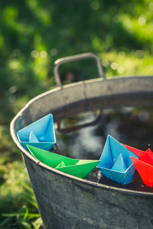 Small paper boats as toned and filtered photo Stock Photo