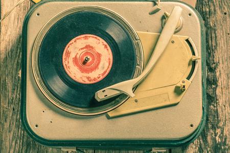 Antique record player and few vinyl records Reklamní fotografie