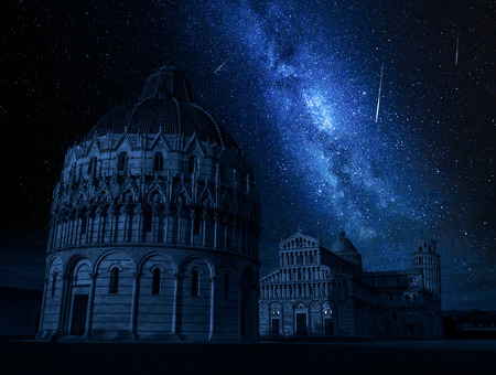 Milky way over monuments in Pisa at night, Italy Stock Photo