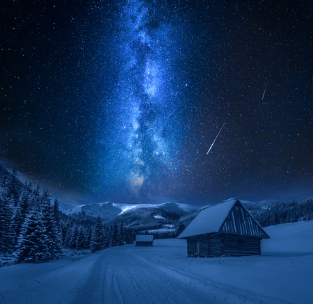 Milky way over snowy road at night, Tatra Mountains Фото со стока