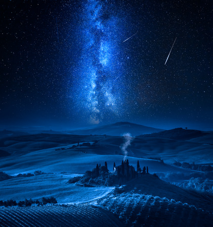 Milky way over farm of olive groves and vineyard, Tuscany