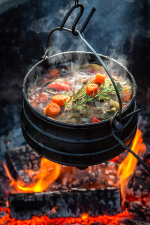 Tasty and homemade hunters stew on campfire 写真素材