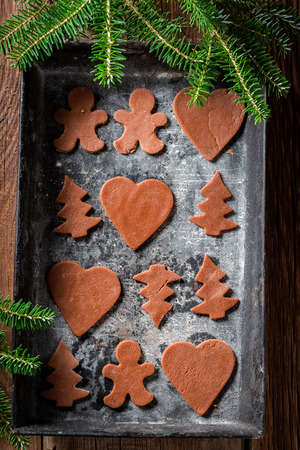 Top view of aromatic Christmas gingerbread cookies in baking tray