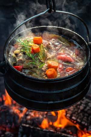 Delicious and fresh hunters stew on campfire
