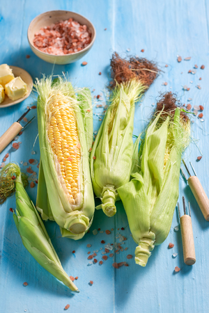 Preparations for grilling fresh corncob with salt and butter