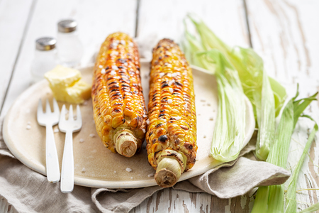 Hot and delicious corn from grill with salt and butter Stock Photo