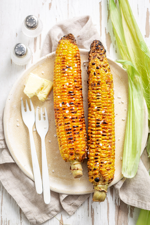 Grilled sweet and salty corncob with butter and salt