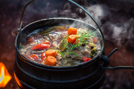 Delicious and fresh hunters stew on bonfire