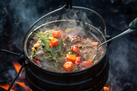 Hot and yummy hunters stew on bonfire