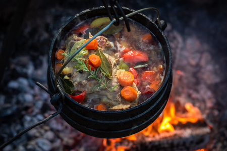 Tasty and homemade hunters stew with vegetables and herbs