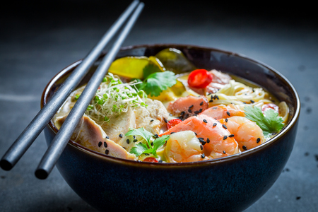 Closeup of delicious Malaysian Soup with chicken and shrimps
