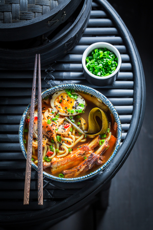 Top view of Kimchi soup with noodles and kombu algae Stock Photo