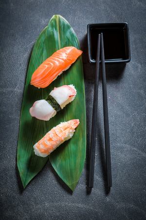 Top view of Nigiri sushi with octopus, prawn and salmon