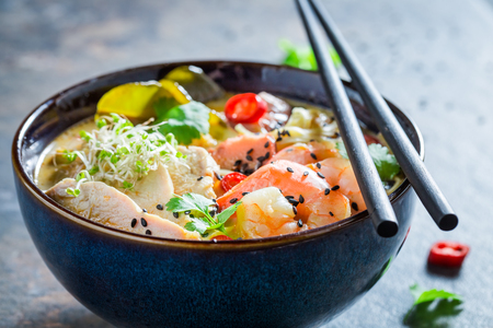 Malaysian Soup with coconut milk and prawn on concrete table Stock Photo - 112898557