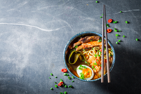 Top view of Kimchi soup with chive and noodles Stock Photo