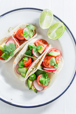 Top view of tasty tacos on white table