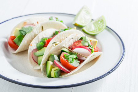 Vegetarian tacos as a snack on white table