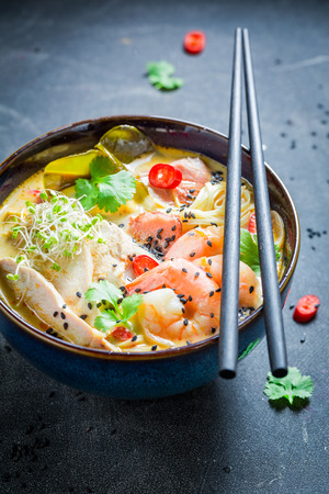Closeup of malaysian Soup with prawn and coconut milk