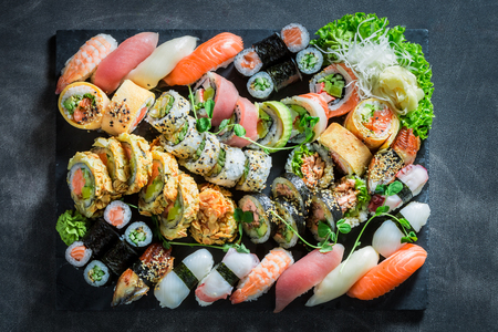 Top view of sushi set made of avocado and salmon