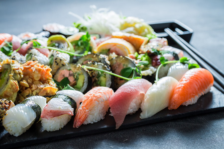 Sushi set with shrimps and rice on concrete table Stock Photo