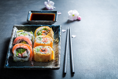 Sushi mix with vegetables and seafood on concrete table Banco de Imagens