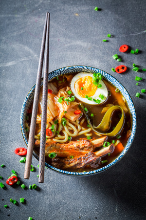Closeup of tasty Kimchi soup with chive and noodles