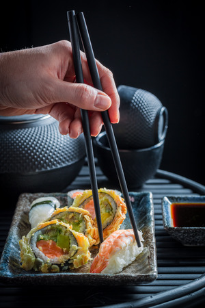 Tasting sushi set with shrimps and rice on dark table Stock Photo