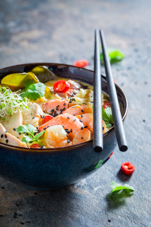 Closeup of yummy Malaysian Soup with prawn and coconut milk Stock Photo