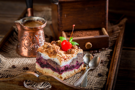 Closeup of cherry pie and boiled coffee on wooden tray