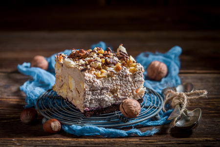 Closeup of homemade meringue with walnuts and chocolate